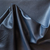 Crumpled piece of black cattle genuine leather Royalty Free Stock Photography