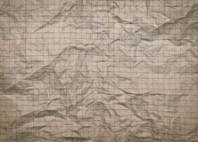 Crumpled piece of paper. The texture of crumpled lined paper close-up Stock Images