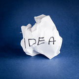 Idea. Crumpled piece of paper with idea written on it Royalty Free Stock Images