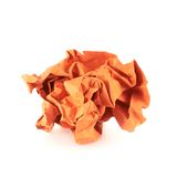 Crumpled piece of paper. Crumpled piece of orange colored paper, isolated over the white background stock image