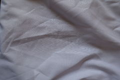 Crumpled plain cotton fabric from above Stock Photography