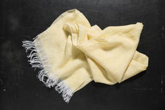 Crumpled Plain Yellow Hand Towel on Smooth Black Surface Royalty Free Stock Photo