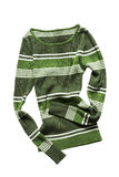 Crumpled pullover isolated. Green striped crumpled pullover isolated over white Stock Photo