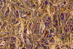 Crumpled Purple and Gold Tin Foil Texture Stock Images