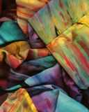 Crumpled rainbow sari. Scanned detail of a crumpled silk sari dyed in a random rainbow of colors Royalty Free Stock Photos