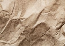 Crumpled recycled brown wrapping paper background. Close-up of crumpled recycled brown wrapping paper background stock photo