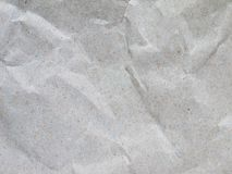 Crumpled recycled gray packing paper stock photo
