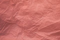 Crumpled recycled pink paper texture and background for design. Close up view of abstract wrinkled pink texture. Crumpled recycled pink paper texture and royalty free stock image