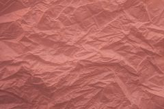 Crumpled recycled pink paper texture and background for design. Close up view of abstract wrinkled pink texture. Crumpled recycled pink paper texture and stock images