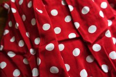 Crumpled red cotton with polka dot print Royalty Free Stock Image