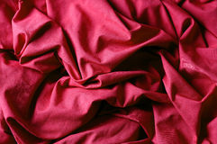 The crumpled red fabric royalty free stock photography