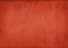 Crumpled red paper background. Crumpled and creased red paper, grunge background stock images