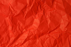 Crumpled red paper. For background stock image