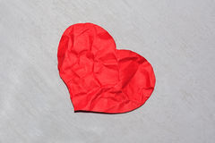 Crumpled red paper heart Stock Photography