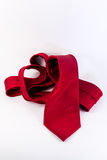 Crumpled Red Silk Tie on White Vertical Background Royalty Free Stock Photography