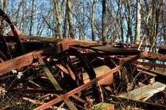 Collapsed oil Derrick in the forest. The crumpled remains of a collapsed oil Derrick in the forest rust away with time Royalty Free Stock Photo