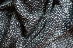 Crumpled salt and pepper tweed fabric Royalty Free Stock Photo