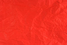 Crumpled scarlet paper. (as a background Stock Photo