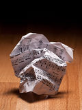 Crumpled sheet of music notes. Crumpled paper sheet of music notes on the floor, closeup,for music composition themes Stock Photos