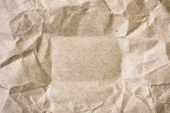 Crumpled sheet of packing beige paper Royalty Free Stock Photo