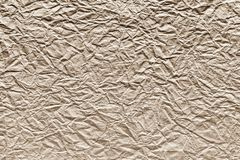 Crumpled sheet paper of beige color Stock Photo