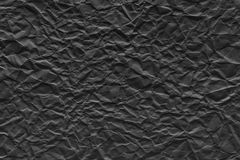 Crumpled sheet paper of black color Royalty Free Stock Photography