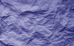 Crumpled sheet of paper in blue color. Abstract background and texture for design, surface, , pattern, old, wallpaper, vintage, retro, decorative, backdrop royalty free stock images