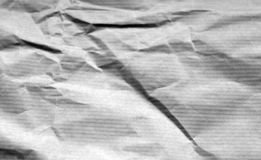 Crumpled sheet of paper with blur effect in black and white. Abstract background and texture for design royalty free stock photo