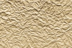 Crumpled sheet paper of cream color Stock Photos