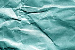 Crumpled sheet of paper in cyan color. Abstract background and texture for design royalty free stock images