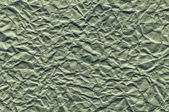 Crumpled sheet paper of green color Stock Images