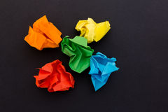 Crumpled sheets of colored paper on a black background Royalty Free Stock Photography