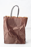 Crumpled shopping paper bag Stock Photos