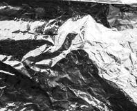 Crumpled silver foil as a background Royalty Free Stock Images