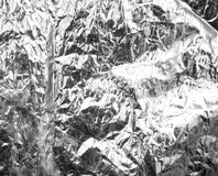 Crumpled silver foil as a background Stock Image
