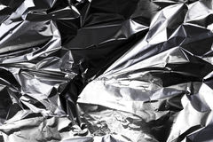 Crumpled silver foil Stock Images