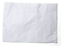 Crumpled squared sheet of paper  on white Royalty Free Stock Photo