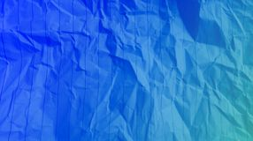 Crumpled stripes lines paper sky blue blue color mixture multi colors effects  Background. stock photo