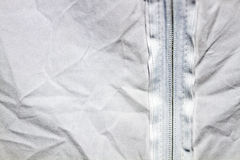 Crumpled textile background. White and grey crumpled textile background with a closed zip lock on back side royalty free stock photos