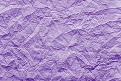 Crumpled texture fabric of bright lilac color Stock Photos