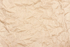Crumpled textured kraft paper. As background Royalty Free Stock Photos