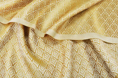 Crumpled thai silk fabric. Textured background royalty free stock image