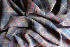 Crumpled thick plaid fabric in subdued colors. Crumpled thick plaid fabric  in subdued colors Royalty Free Stock Photos