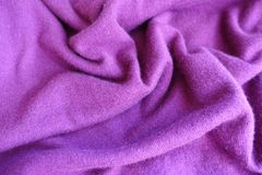 Crumpled thin fuchsia colored knitted fabric Stock Photo