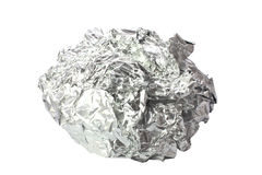 Crumpled tin foil isolated. Tin foil crumpled into a ball shape isolated on a white background using clipping path Stock Photos