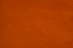 Crumpled tissue paper background. Orange crumpled tissue paper background Stock Photos