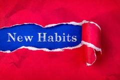 Crumpled Torn red Paper and New Habits text with  a blue paper b Royalty Free Stock Image