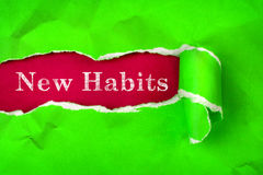 Crumpled Torn vibrant green Paper and New Habits text with  a re Stock Photo