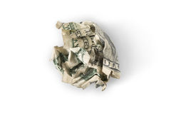 Crumpled up dollar bill. A crumpled up dollar bill on white with shadow, 'trash' or 'throwing money away' concept royalty free stock images