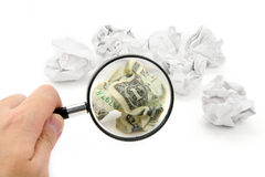 Crumpled usa dollar ball and magnifier Royalty Free Stock Photos